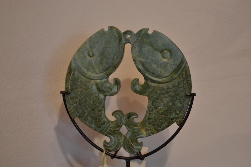 Disco in pietra intarsiata